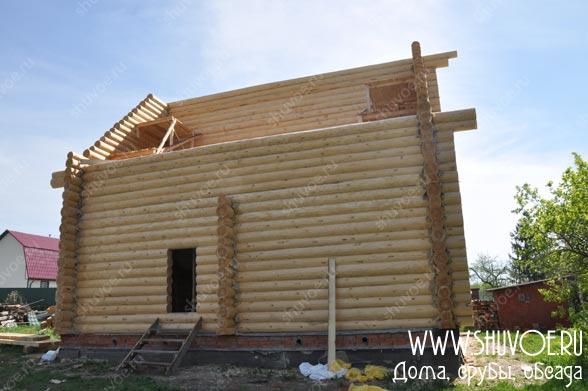 Строительство дома с рублеными фронтами