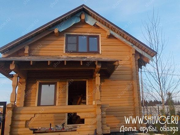 Обсада дома из лафета с установкой окон