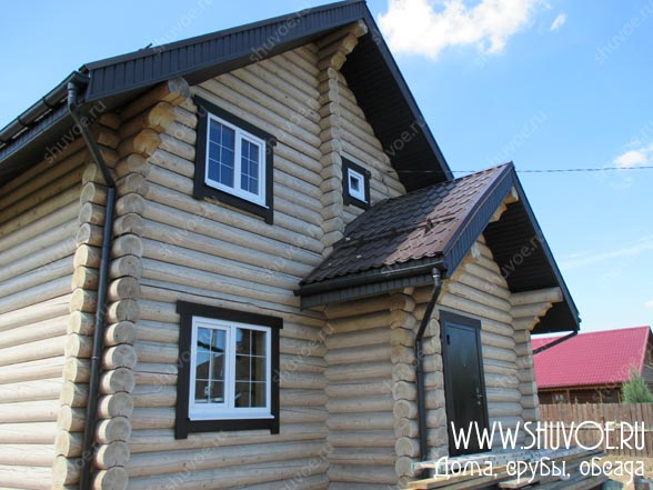 Строительство деревянного дома - установка окон и дверей