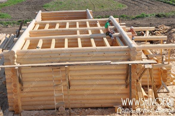 Строительство дома с верандой на основе сруба.